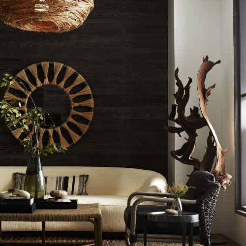modern living room featuring black marble accent table with natural accents of driftwood sculpture, and organic hues of earth tones. Beautiful way to express your global inspired living space.