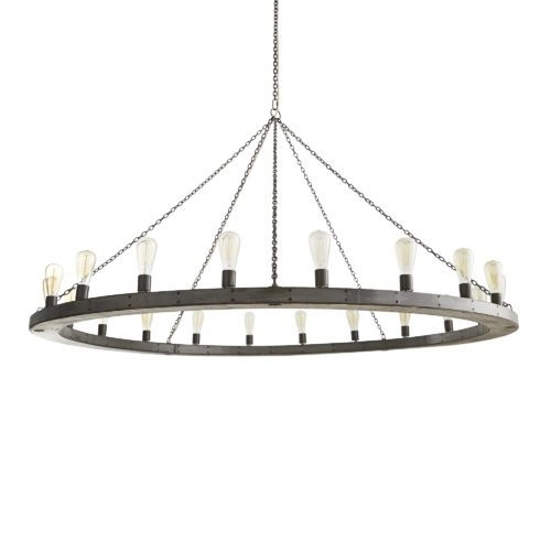 Hanging by a purposely rusted chain, the gray-washed mango wood ring makes an impressive statement when hanging from a beam in a great room or hung above a large round dining table. The Edison bulbs in the photo reinforce the rustic, industrial feel.