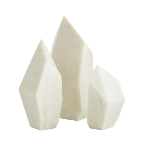 Like geometric pillars, these sculptures add a bit of modern sophistication to a table, desk or shelf. The ivory finish makes them almost identical to marble, with even, prism surfaces andclean lines with modern class. They provide form or function, whether as bookends and paperweights or simply as decorative accents to elevate a look.